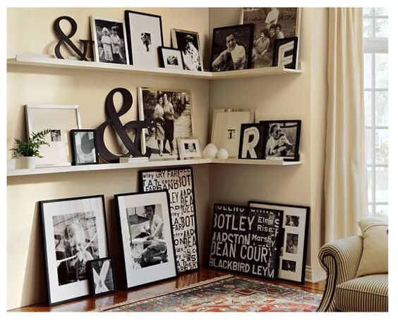 Great shelving idea for living room. Love the different shapes, sizes of frames.