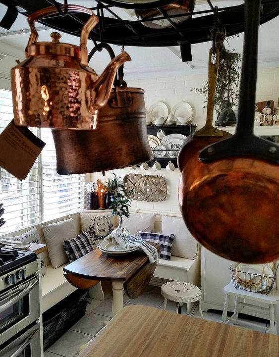 copper collection in a French Country Farmhouse Kitchen