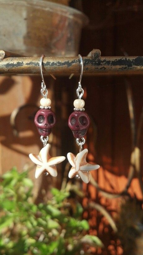 Wine colored skulls with white star dangles.