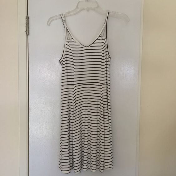 Striped strappy dress Flows at the bottom but fitted in the mid section. Will fit a size medium comfortable and a small kind of loosely. Junior sizing from kohls. I have not gotten around to wearing this before , I've only tried it on. Mudd Dresses Mini