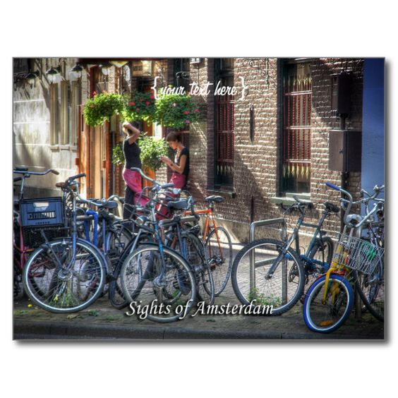 Typical Street Scene, Sights of Amsterdam Postcard Amsterdam series: A postcard showing a typical tableaux in Amsterdam - two waitresses are taking a break behind a stand of the ubiquitous bicycles so common in this fair city. The girls are caught in a private moment by the sunshine peeking though the clouds. more Amsterdam items more items with this image image code: hrcol139...read more
