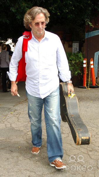 Eric Clapton has lunch at Orso restaurant, then walks back to his car with his guitar in West Hollywood.