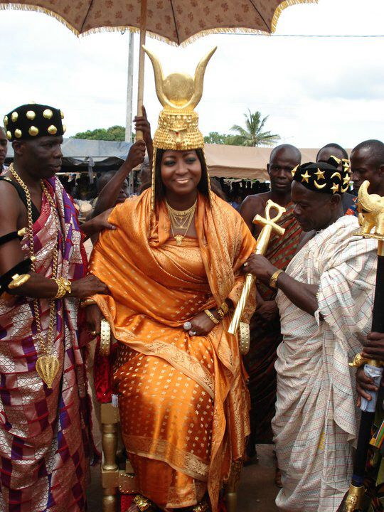 West African royalty; note the symbols adorning the headdress, similar to that of Hathor, as well the African Ankh apparent on the staff.