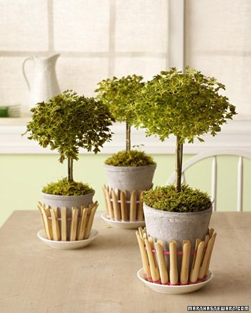 Cute picket fence idea for planters.