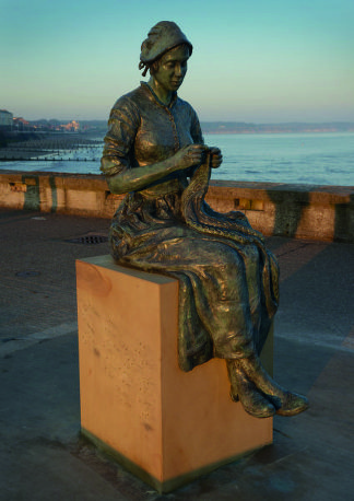 The Gansey Girl: a bronze sculpture in Bridlington, UK, devoted to knitting. It pays tribute to Bridlington's fishing history now sits on the harbour's North Pier as a reminder of the town's maritime past. Designed by Steve Carvill, it also marks the 10th anniversary of the Bridlington Maritime Trail.