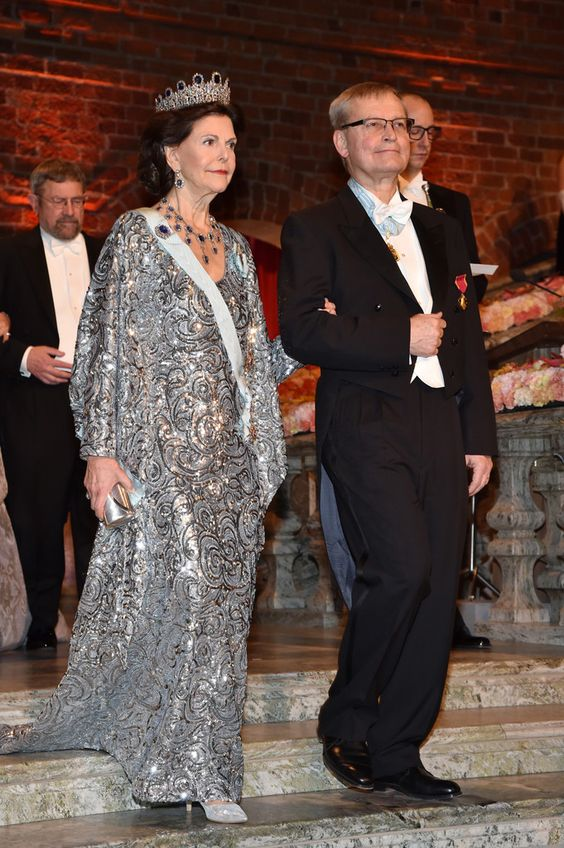 Queen Silvia of Sweden and Chairman of the board of the Nobel Foundation, Professor Carl-Henrik Heldin arrive at the Nobel Prize Banquet 2015 at City Hall on December 10, 2016 in Stockholm, Sweden.