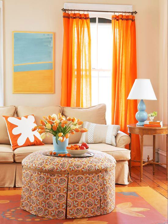 The patterned ottoman inspired this room's bright color scheme. More ways to add color: http://www.bhg.com/rooms/living-room/family/real-life-colorful-living-rooms/?socsrc=bhgpin041112orangeroom