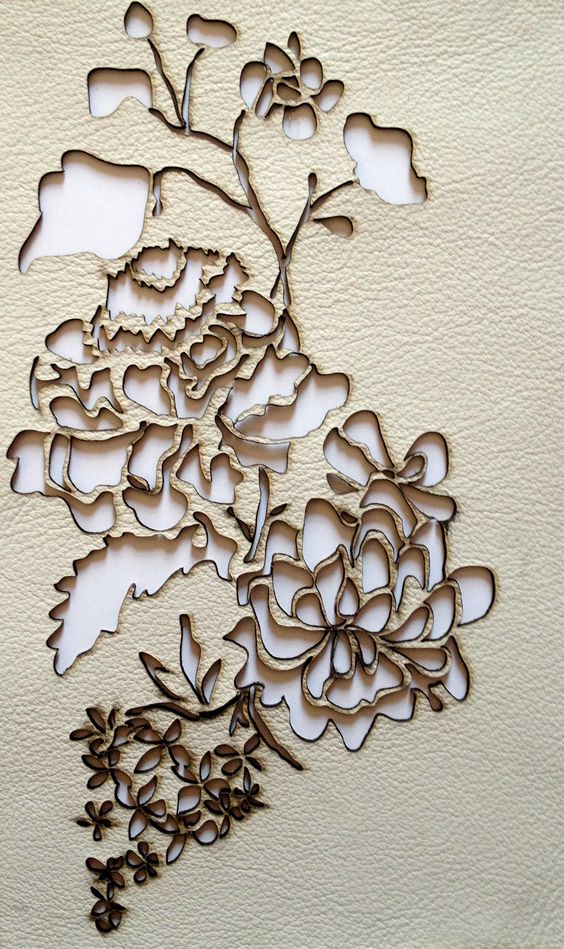 Here is a cut out of a flower done in leather. For my Digital work we will be cutting into a piece of material using the lazercutter this has gave me an idea to maybe cut into leather.
