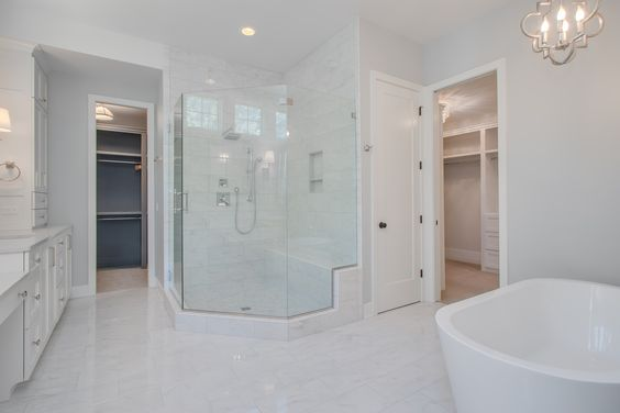 Owner's Suite: ceramic tile floor and matching shower surround, glass walk in shower, his and hers walk-in closets, large soaking tub, painted cabinets