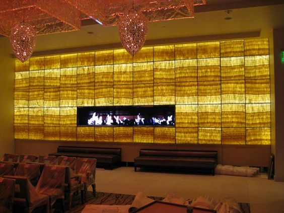 Onyx Backlit With Led Lighting With An Oversized Fireplace