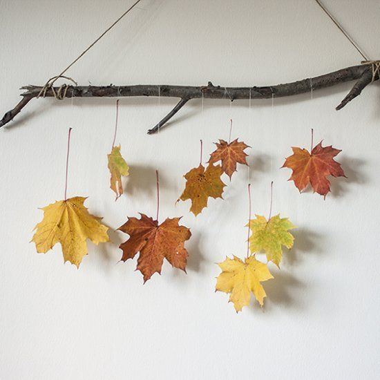 DIY fall decoration with a branch and some autumn leaves. Put some color into your home!
