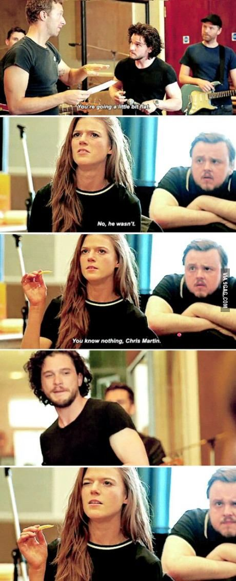 During the GOT cast's Red Nose Day prep with Coldplay, Rose Lesie (Ygritte) defends her man, Kit Harrington, (Jon Snow) the best way she knows how, as John Bradley-West (Samwell Tarley) looks on. Watch out for the Ygritte-sass, Chris Martin