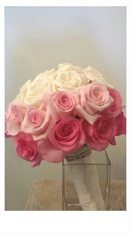 An ombre wedding bouquet featuring all roses, wrapped in satin with a crystal pin. www.janesblueiris.com