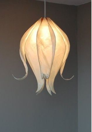 closed flower lampshade. made from tissue paper and wire then place lampshade over pendant light
