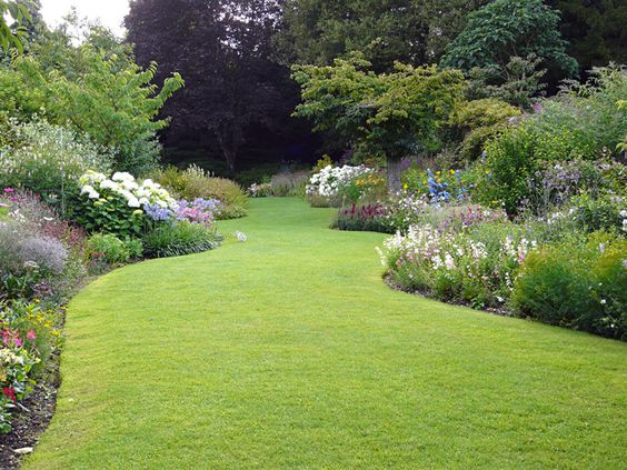 The Secret Garden, a curving English herbaceous border originally designed for the 6th Earl of Carnarvon by Jim Russell