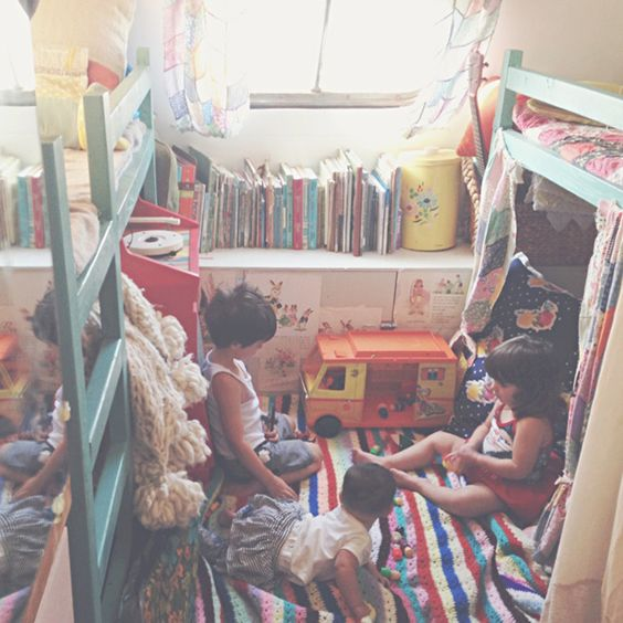This is the kids room (four of them) in a vintage trailer!