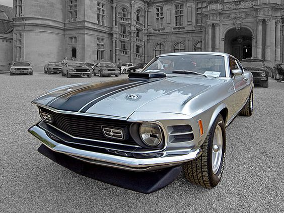 Standing out from the crowd, a 1970 Mach1 Ford Mustang, a classic American muscle car. #americanmuscle #musclecars #coolcars #ponycars #fordmustang