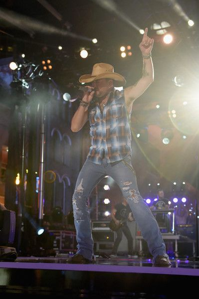 Jason Aldean Photos Photos - Singer-songwriter Jason Aldean performs onstage during the 2016 CMT Music awards at the Bridgestone Arena on June 8, 2016 in Nashville, Tennessee. - 2016 CMT Music Awards - Show