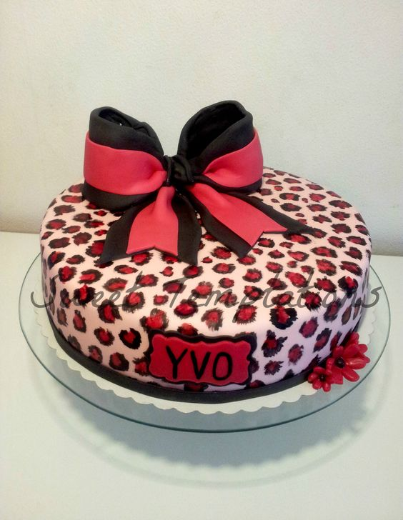 Pink Leo cake - Birthday cake with pink leoprint and bow for a cheerleader !! Cake is filled with Sponge and ganache!
