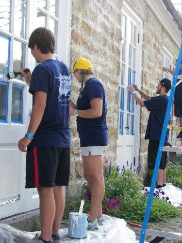 Adventure WV Service Day...volunteers paint at Arthurdale Heritage Foundation!