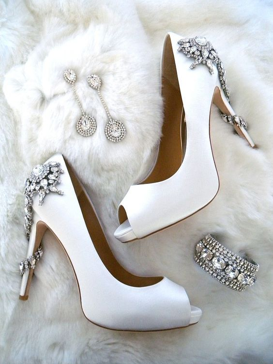 Bridal Accessories for the winter bride. The newest jeweled shoes from Badgley Mischka wedding shoes, Erin Cole couture bridal jewelry and of course a faux fur to chase away the chill.: