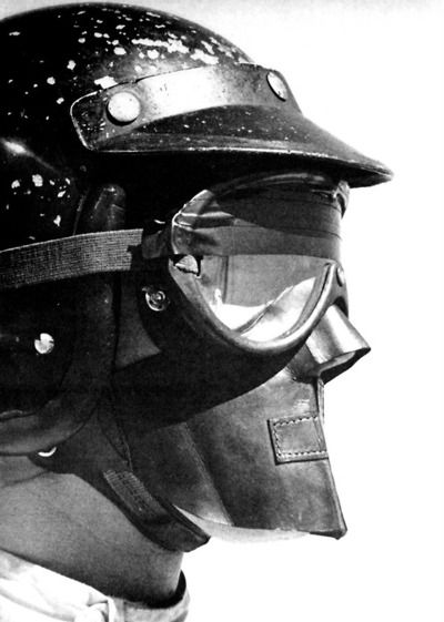 Dan Gurney & his famous Bell helmet  Dan would be the first to wear a, modern, full face helmet, in the 1968 German Grand Prix at the Nürburgring---I wonder if the tape over the top of the goggles was to act as a sunshade, or if it held a primitive tearoff