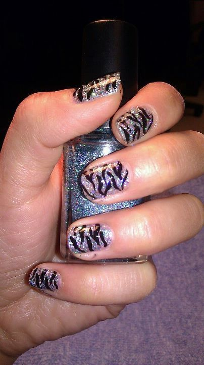 Zebra print in black on top of glitter nail polish shows up fantastically! Fun, easy, enjoy!