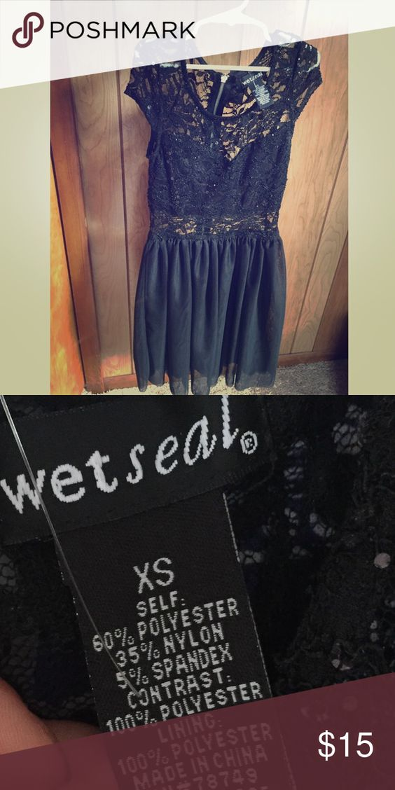 Brand new Wet Seal lace midi dress Brand new Wet Seal dress with original retail tags. Never worn. Cute lace designed with cut outs. Wet Seal Dresses Midi