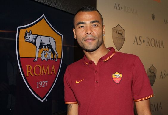 New signing Ashley Cole poses for photographs during the press conference at the AS Roma Training Centre on July 15, 2014 in Rome, Italy