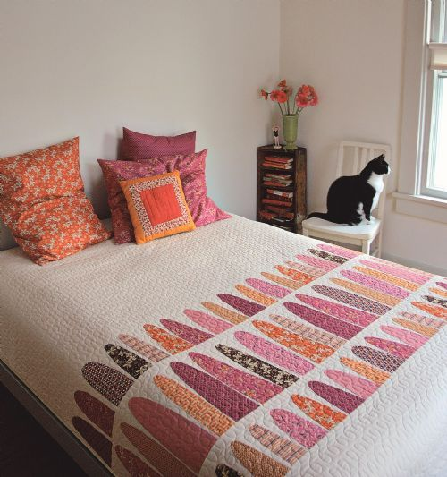 Great room styling and the quilt looks lovely pulled taut over the bed.  Denyse Schmidt Quilts