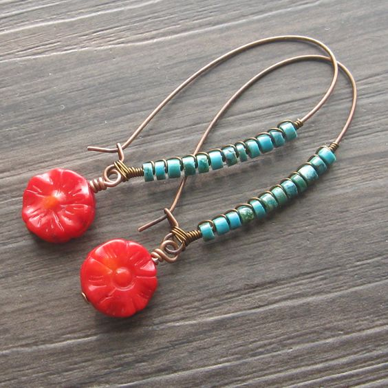 Turquoise and coral wire wrapped earrings - long kidney wire earrings - bright turquoise red coral earrings. $28.00, via Etsy.