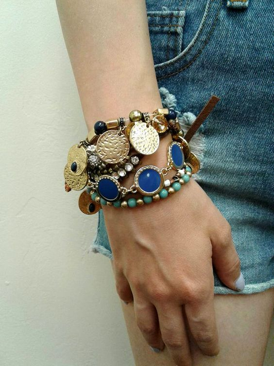 Less is certainly NOT more in this case! Accessorize any outfit by layering some #SuperCute #boho bangles! Add a variety of #colors, #jewels and shapes to create the perfect #festival look. #BohoStyle #Gypsy #MustHave #JewelryTrends #PlatosTucson | www.platosclosettucson.com