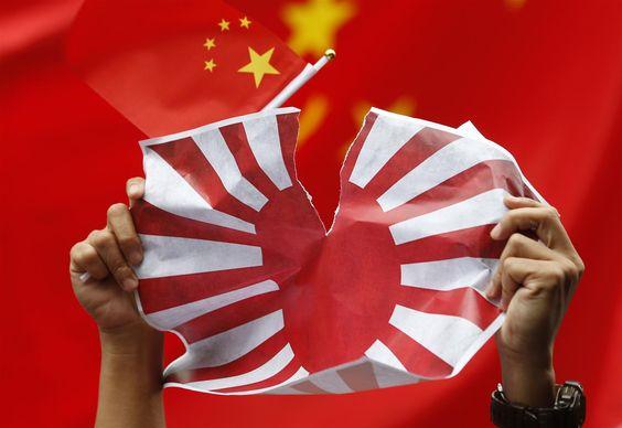 japanese rising sun flag | An anti-Japan protester tears Japanese Rising Sun Flag during a rally ...
