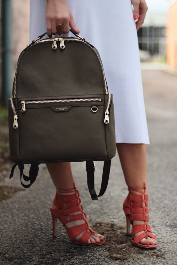 Complete your designer luggage collection with the West 57th Travel Backpack. Crafted with fine Saffiano leather, this luxury backpack boasts ample and organized storage, replete with an interior laptop compartment. Grommet-adorned hardware and a luscious satin lining finish the decadent features of this must-have travel companion.
