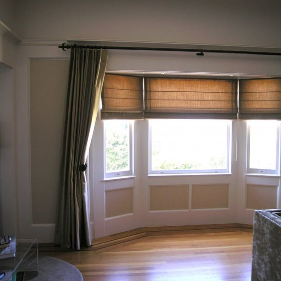 Light is easily controlled with this layered treatment in for Window treatments for a bay window