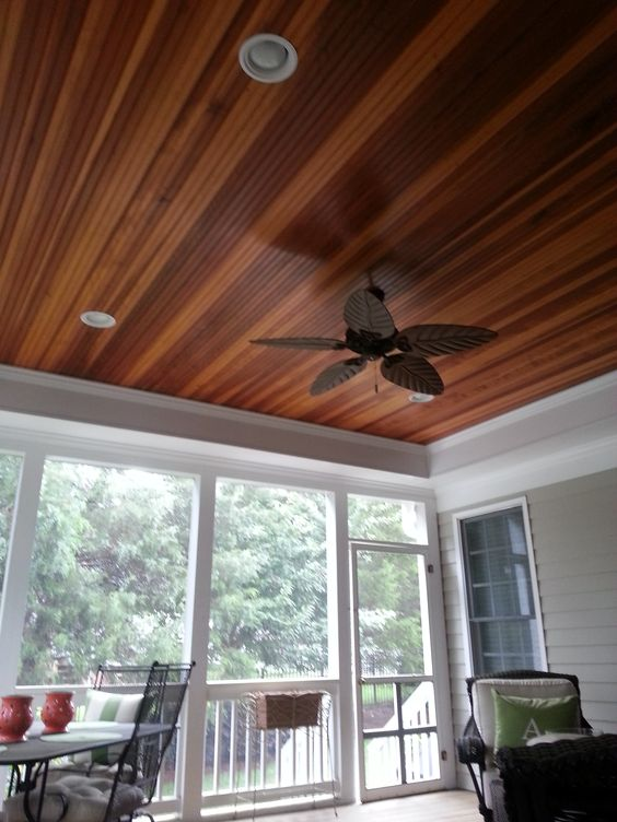 Great Screened In Porch With A Tray Ceiling And Redwood
