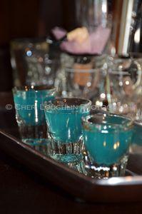 Blue Balls    (1 measure Blue Curacao    1 measure Coconut Rum    1 measure Peach Schnapps    1 measure Lemon Juice)