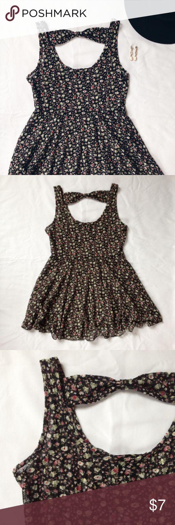 Vanity Black Floral Shirt Dress Super cute floral shirt dress! Gently used, lots of life left though. Scoop neck, lower back with bow detail. Sheer material, would need to wear an under shirt. Flares out around waist. Not long enough to wear as a dress, but would look super cute with leggings or shorts. Vanity Tops Tank Tops