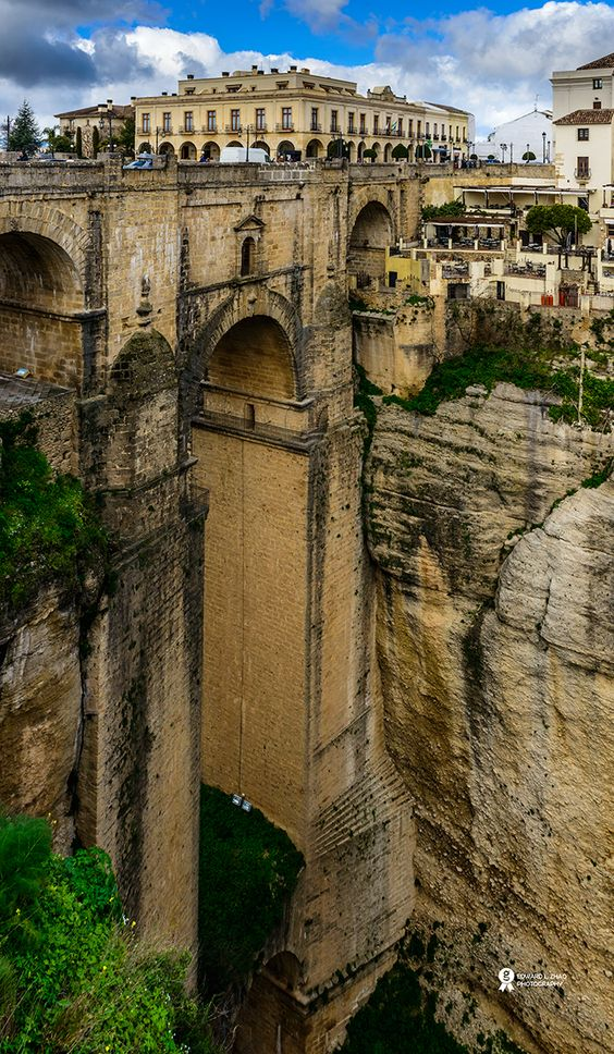 Roma Bridge, Ronda, Spain. Ronda is a city in the Spanish province of Málaga. It is located about 100 kilometres west of the city of Málaga, within the autonomous community of Andalusia.