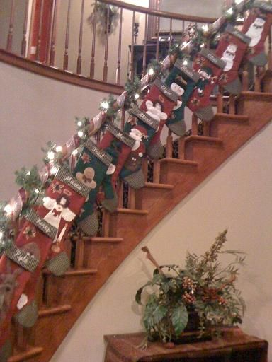 hang christmas stockings on a stair garland christmas