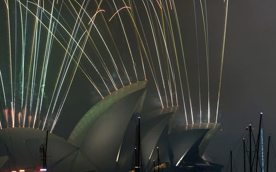 New Year's Eve fireworks erupt over Sydney's iconic Harbour Bridge and Opera House during the traditional fireworks show