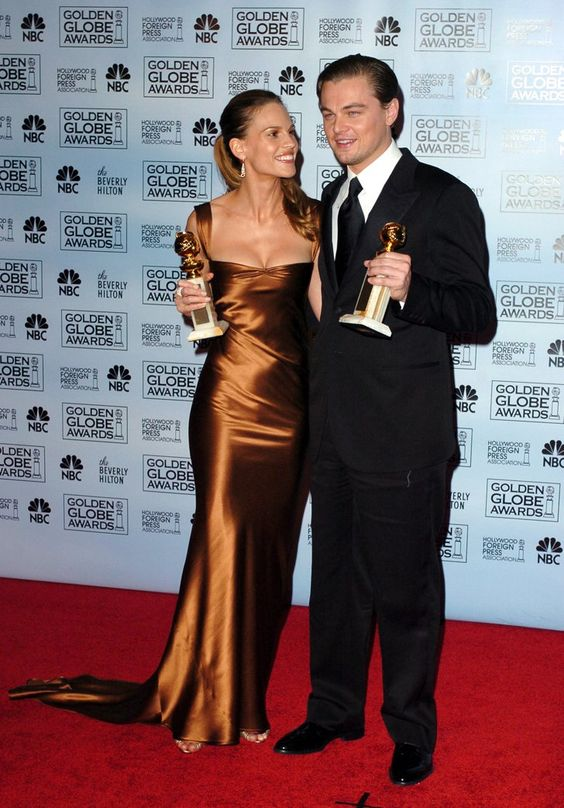 Pin for Later: Leonardo DiCaprio and the Many Ladies in His Life  He won the best actor Golden Globe award in 2005 for his role in The Aviator and smiled for photos backstage with best actress winner Hilary Swank.