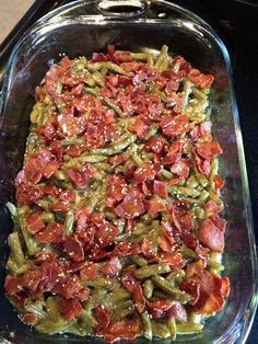 CRACK GREEN BEANS  Green beans, drained (note: you can substitute a similar amount of frozen green beans, about 4 (12-ounce) bags, thawed, or you can use fresh green beans, too) 12 slices bacon 2/3 cup brown sugar 1/4 cup butter, melted 7 teaspoons soy sauce 1 1/2 teaspoons garlic powder      Put the drained beans in a 9x13 pan.  Add the cooked bacon pieces.  Mix the remaining ingredients ( the crack sauce). Pour over the beans and bake 40 minutes at 350.  Toss and serve.