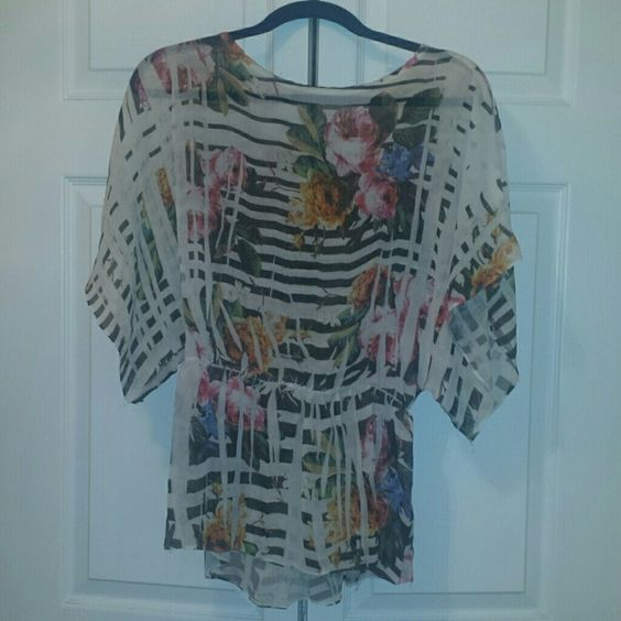 Floral shirt Medium flowered flowy top with elastic rouched waist from Forever 21. Some loose strings here and there, overall still in good shape. Forever 21 Tops Blouses