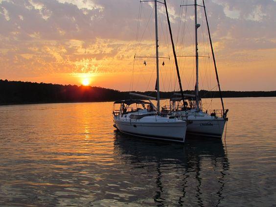 Two Hunter Sailboats anchored on sunset on Mobjack Bay, VA