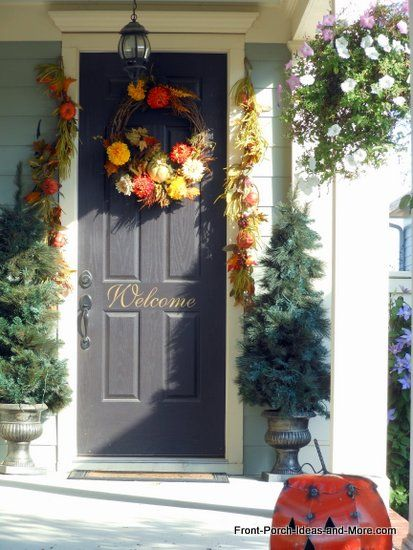 Natural fall wreath and beautiful front door make this a welcoming entryway :: Front-Porch-Ideas-and-More.com #wreath, #autumndecor