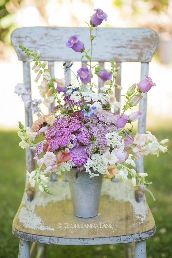 Summer flowers by Georgianna Lane, Floret Flower Farm: Sunset-hued Achillea, snapdragons, Queen Anne's Lace, foxglove, Campanula, Nigella damascena, dahila, larkspur: