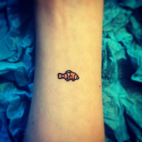 Nemo tattoo.... This is beyond perfect!!! This is how I want mine to look. I'm in love with this.