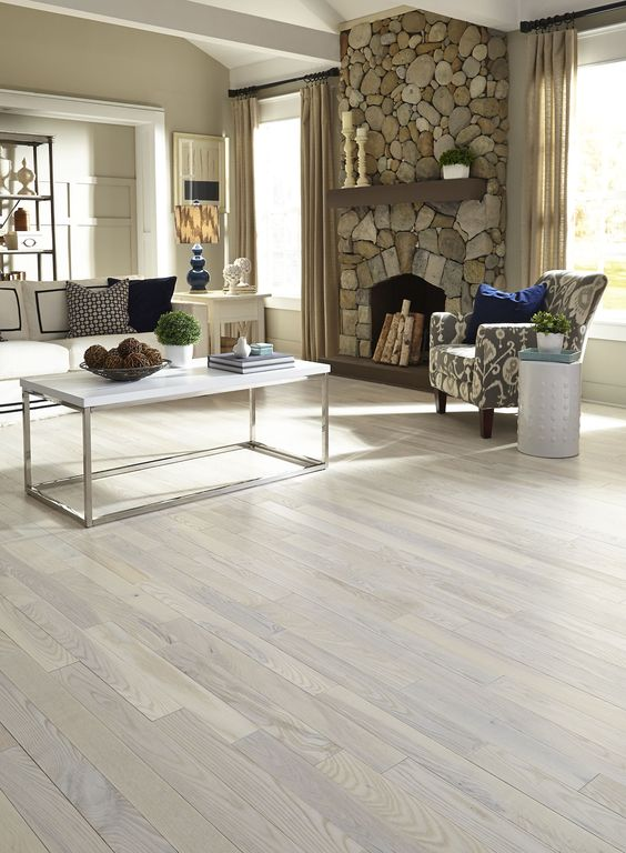 One flooring style that makes a small room look bigger is for Carriage house flooring