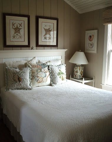 This link has several ideas for Nautical/coastal bedrooms.  I Like the pictures above the beds.